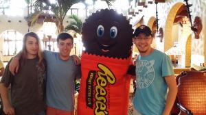 Figure 2: Perhaps the epitome of chocolate-based entertainment, a living Reese's cup poses with a Harvard student and friends.