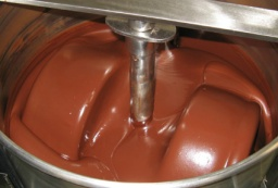 Picture above is an inside view of a modern conche, used by Bright River Chocolate.  The smooth texture of the chocolate in the image is characteristic of conched chocolate.