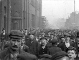 These working-class men leaving a factory in 1900 would be entitled to the lion's share of their family's protein and carbohydrates in a gamble to protect the health of the primary breadwinner at the expense of his wife and children's caloric intake.