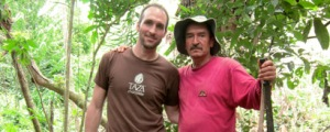 Taza Chocolate founder Alex Whitmore with chocolate farmer.