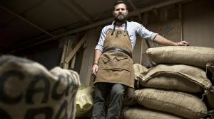 Ryan Berk with cocoa beans that he directly selected and paid for