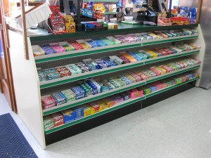 Candy bars are typically sold at check out counters like this, implicating them as impulse purchases: something to buy last minute before you pay and go.