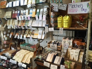 This image shows the main chocolate section of Formaggio Kitchen in Cambridge. Note the small selection and tiny square footage, the curated feel of the display, and the signs handwritten in elegant script. Photo by the author.
