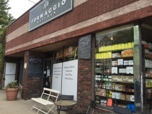 Seen here is part of the storefront of Formaggio Kitchen's Cambridge location, which is tucked away in a semi-residential area, accessible by car, several bus lines, or by foot from Harvard Square (as I did). Photo by the author.