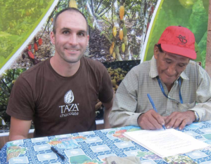 Alex Whitmore and Francisco Poma Cruz, president of the CIAAB Cooperative, signing the Taza Chocolate Direct Trade Agreement. Photo by Nicholas Valverde.