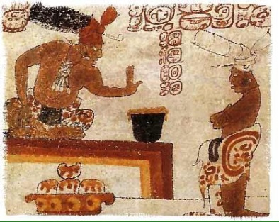Mayan artwork of frothed chocolate beverage.
