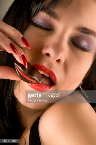 157419194-sexy-woman-holding-chocolate-gettyimages