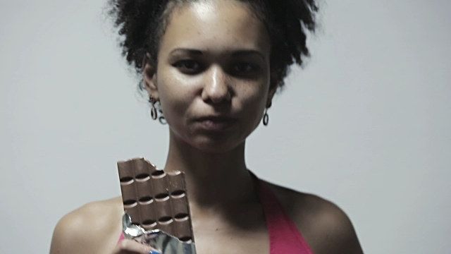 stock-video-73729883-attractive-african-american-woman-eating-chocolate-bar