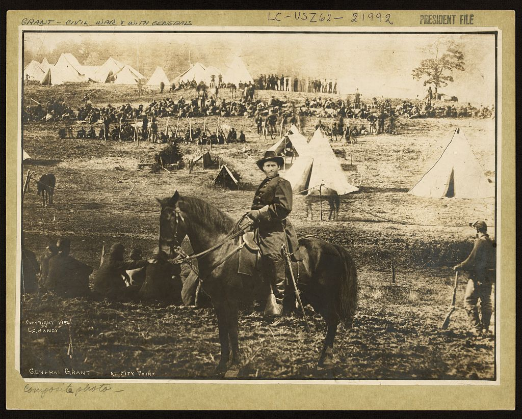 General Grant sits atop of horse in front of Union Army camp