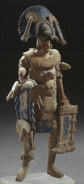 Statuette of Mayan with cacao pods on uniform