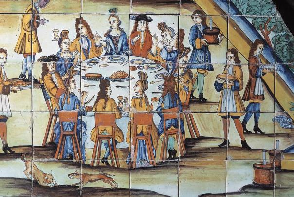The Chocolatada, 1710. Glazed tile panel detailing servants serving chocolate to the table. Barcelona, Spain.