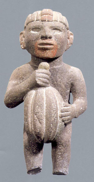Aztec sculpture holding a cacao pod.